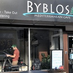 A production company sets up for shooting for the Food Network at the Byblos restaurant on Clinton Street in Syracuse